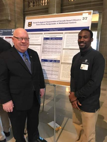 University of Missouri Student Mario Wilson visits with his State Representative Bob Burns in the State Capitol Rotunda. Mario is taking part in the University of Missouri System Undergraduate Research Day. Mario is a Graduate of Hancock Place High School, and his Research Project is Social-Ecological Characteristics of Juvenile Sex Offenders from Diverse Backgrounds: A mediation analysis.